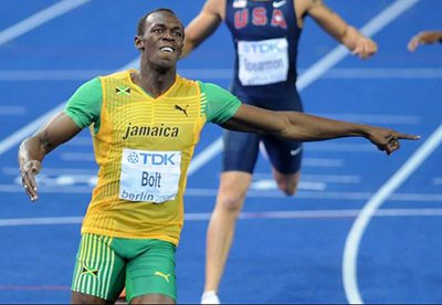 Usain Bolt breaking his own record